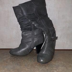 Worn grey boots with heel